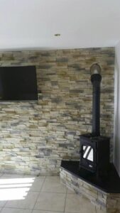 stone-fireplace-behind-the-stove-cladding-grenada-frost