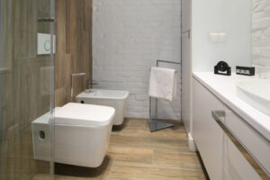 white brick and wood effect tiles in bathroom