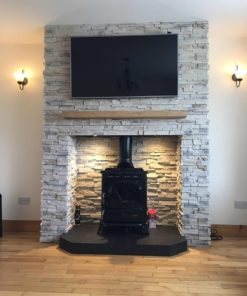 Chimney breast covered with stone