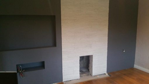 white-stone-cladding-fireplace-wall