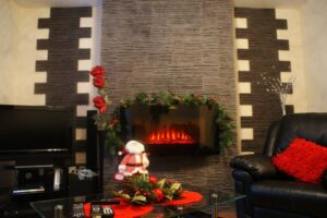 palermo-graphite-thin-stone-fireplace-christmas